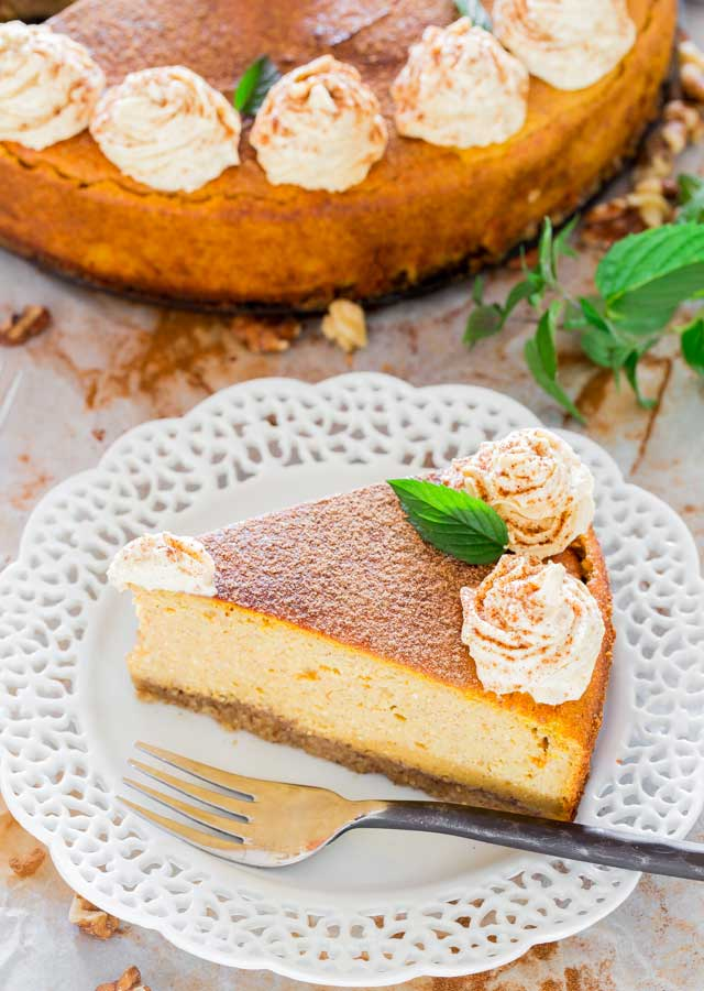 overhead shot of a slice of pumpkin cheesecake on a white plate