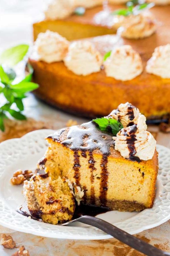 a fork taking a bite of pumpkin ricotta cheesecake