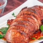 sliced cajun honey pork tenderloin on a plate