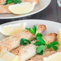 3 pieces of lemony tilapia fish sticks on a plate