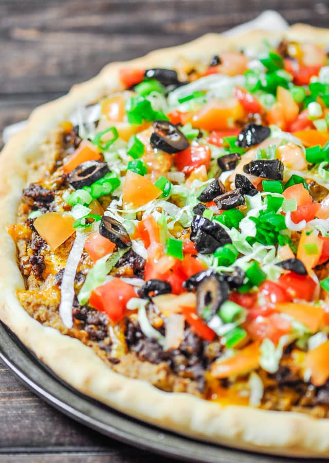 Taco Pizza at home, no more take out, and it's much better. Fresh and healthy ingredients result into one amazingly delicious taco pizza.