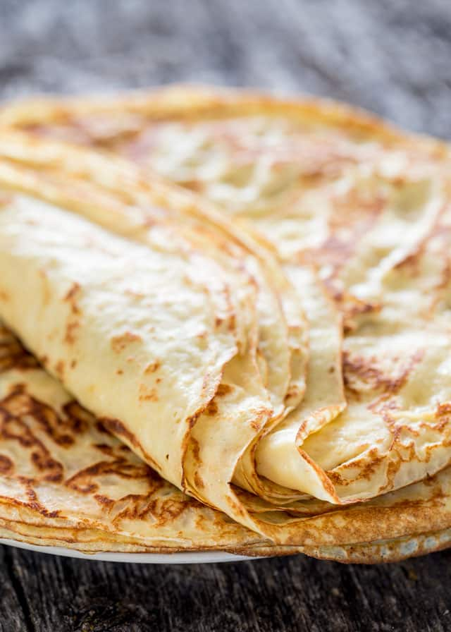 a stack of homemade crepes on a plate