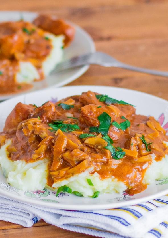 Close up shot of Paprikash Chicken Stroganoff on mashed potatoes