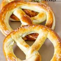 three freshly baked soft pretzels