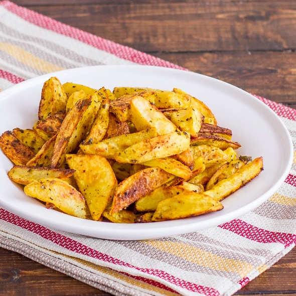 a bowl of crispy indian potato wedges