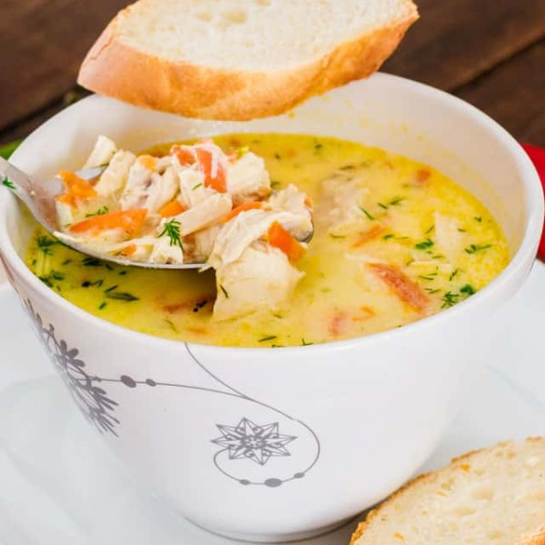 a spoon taking a bite of soup a la grec