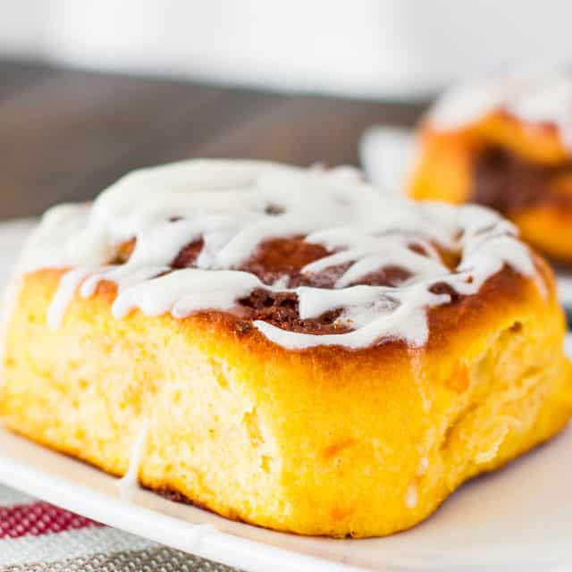sweet potato cinnamon roll with icing on a plate