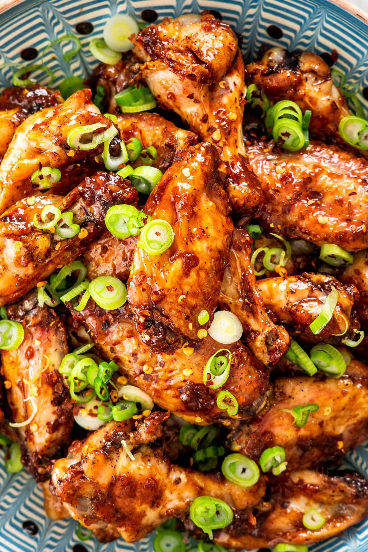 closeup of honey garlic chicken wings in a bowl