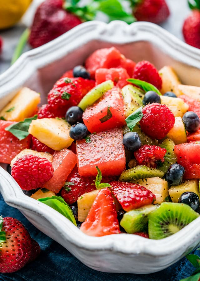 a large serving bowl filled with fruit salad