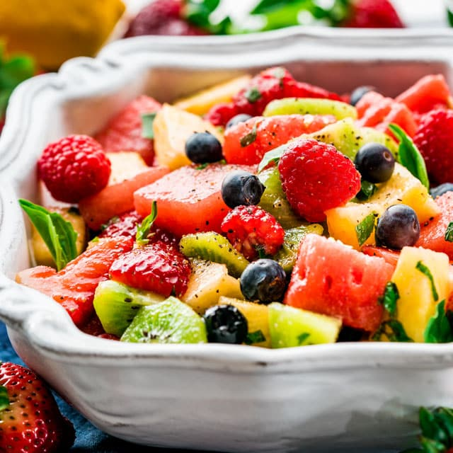 large serving bowl filled with fruit salad