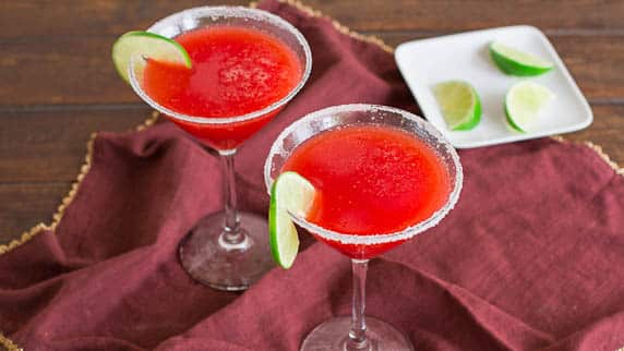 Strawberry Margaritas: fresh strawberries + the makings of a great margarita = party time! Made with fresh strawberries, these margaritas are a refreshing cocktail, that's good till the very last drop!