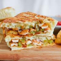 chicken fajita sandwich cut in half and stacked on a cutting board