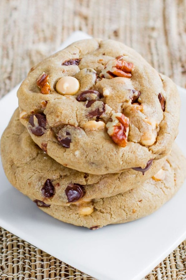 a stack of butterscotch chocolate and pecan cookies on a plate
