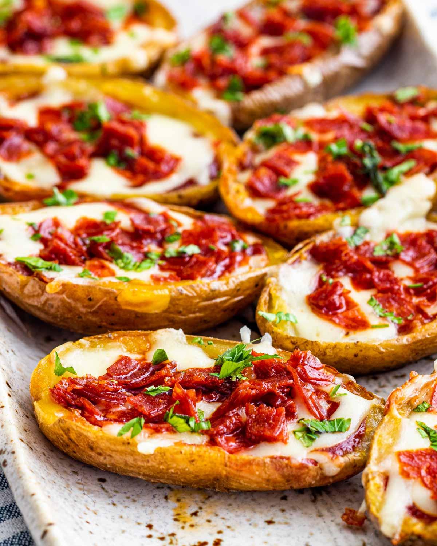 pizza potato skins on a serving platter.