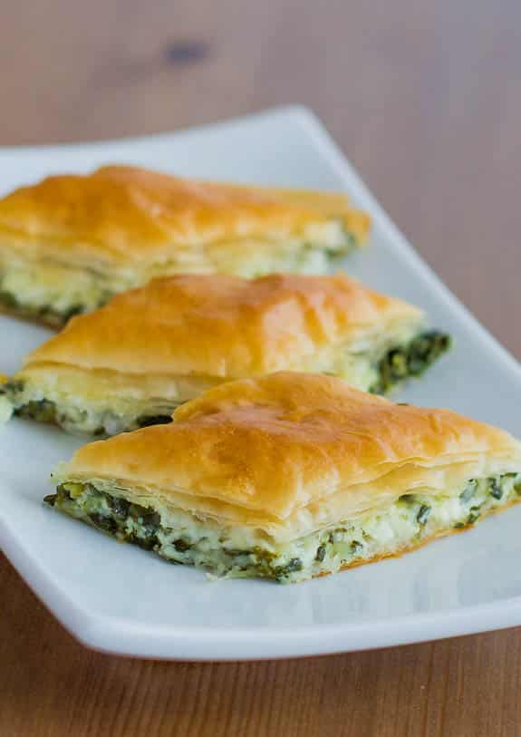 Close up shot of 3 Spanakopita Bites on a plate