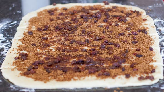 Process shot showing how to make Cinnamon Brown Sugar Pull Apart Bread with Raisins