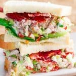easy chicken salad sandwich halves stacked on a plate