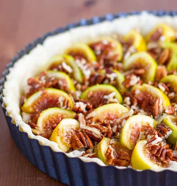 a beautiful fig tart with pecans and goat cheese