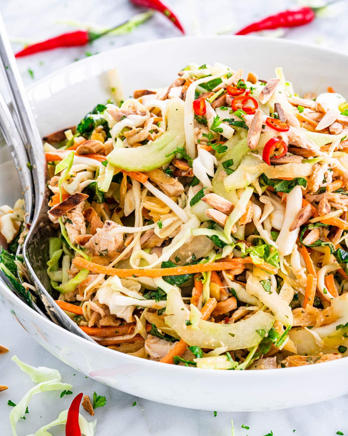 thai chicken salad in a white bowl