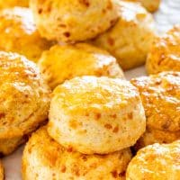 side view shot of cheddar buttermilk biscuits stacked in a pile