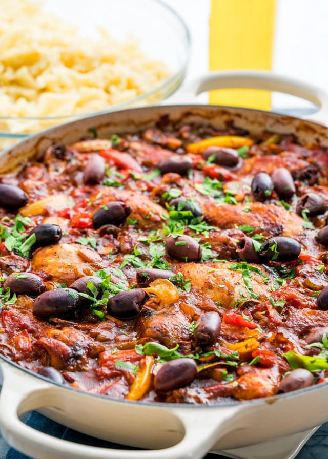 a braiser full of chicken cacciatore and lots of olives