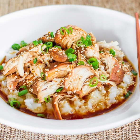 a bowl of rice topped with teriyaki chicken