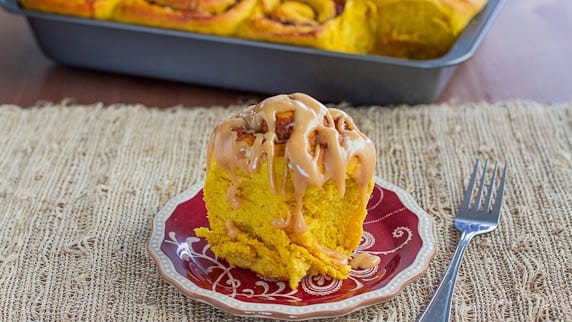 Pumpkin Sweet Rolls with Cranberries and Pecans and Caramel Cream Cheese Icing