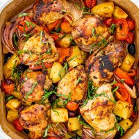 overhead shot of roasted chicken and vegetables in a pan