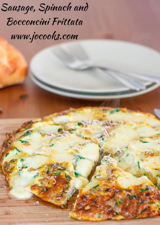Sausage, Spinach and Bocconcini Frittata on a cutting board