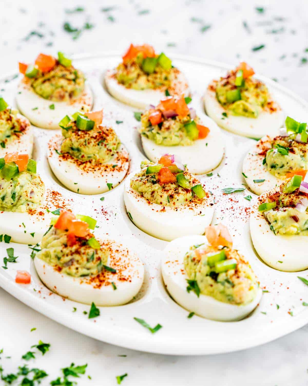 guacamole deviled eggs on a serving platter