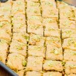 side view shot of pistachio baklava on a baking sheet