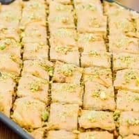side view shot of pistachio baklava on a baking sheet
