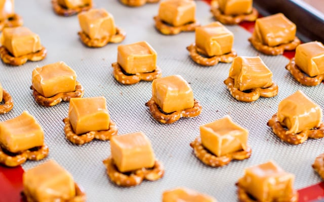 These pretzel turtles are fun to make with your kids. You have a chocolate bottom, topped with a pretzel, then a caramel and finally topped with a pecan.
