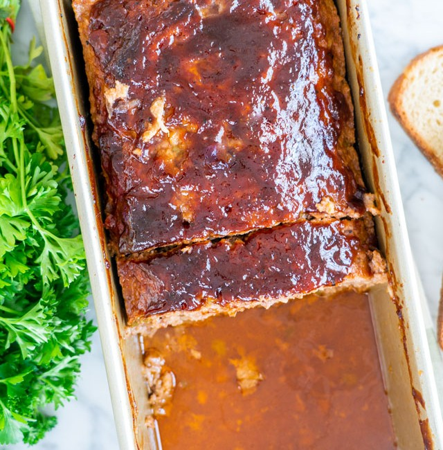 overhead shot of a pan of meatloaf with half missing