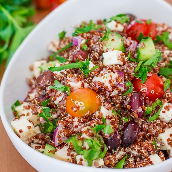 a bowl of greek chicken red quinoa salad