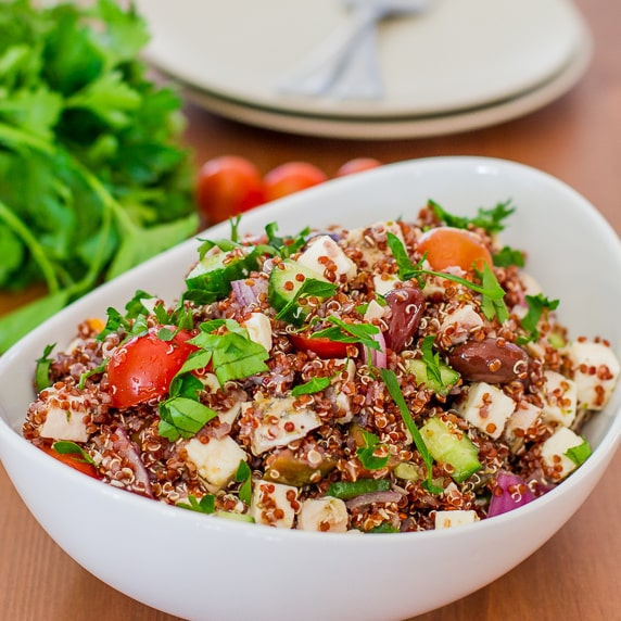 This Greek Chicken Red Quinoa Salad is rich in nutrients, packed with protein and it's super delicious at only 368 calories per serving.