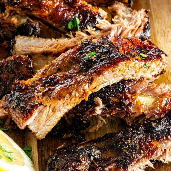 closeup shot of honey glazed pork ribs cut into pieces