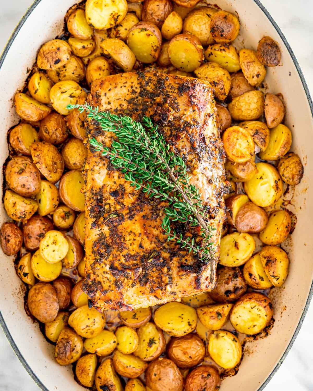 overhead shot of lemon pork roast surrounded by roasted potatoes