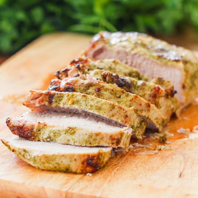 Lemon Garlic Roasted Pork Loin on a cutting board cut into slices