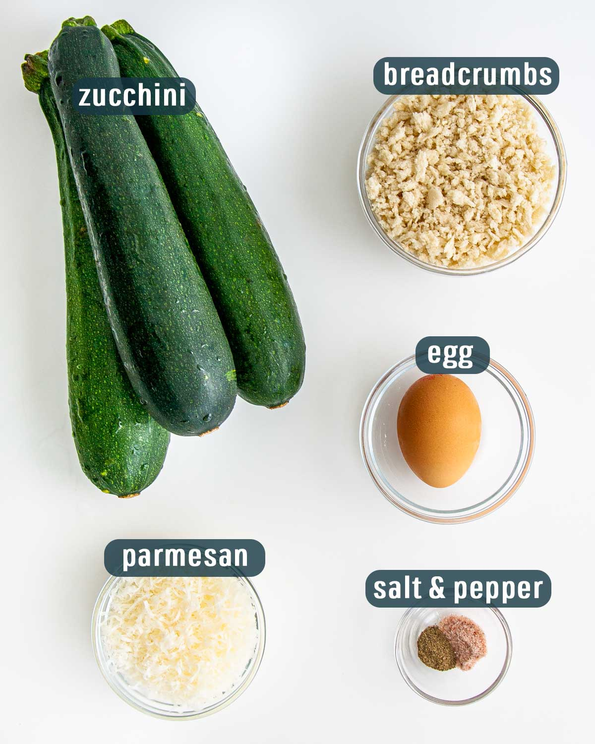 overhead shot of all ingredients needed to make baked zucchini sticks.