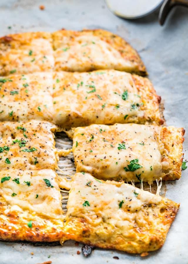 Cheesy Cauliflower Breadsticks - gluten free, low carb, cheesy cauliflower breadsticks! This recipe is a winner and a keeper!