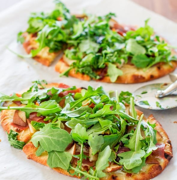 freshly baked pear prosciutto and arugula flatbread