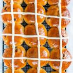 overhead shot of hot cross buns on a cooling rack