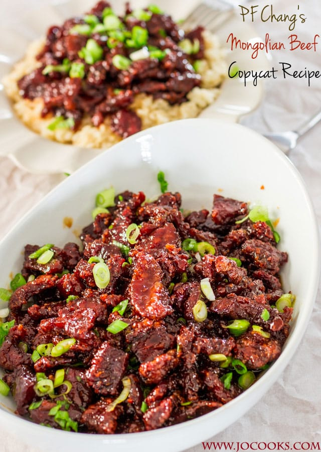 PF Chang's Mongolian Beef Copycat in a white bowl garnished with green onions