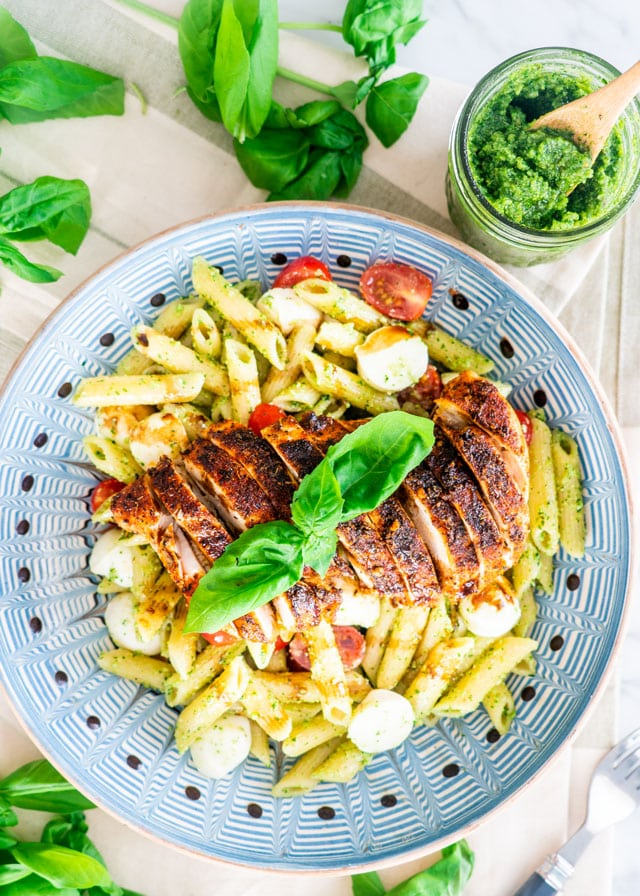 Chicken Pesto Caprese Pasta on a blue plate