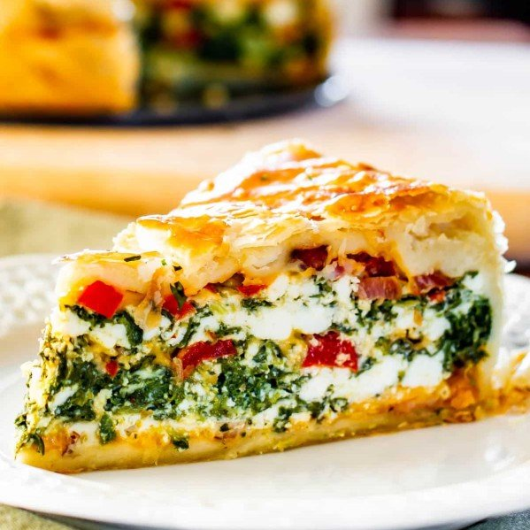side view shot of a plate with a slice of spinach ricotta brunch bake on it