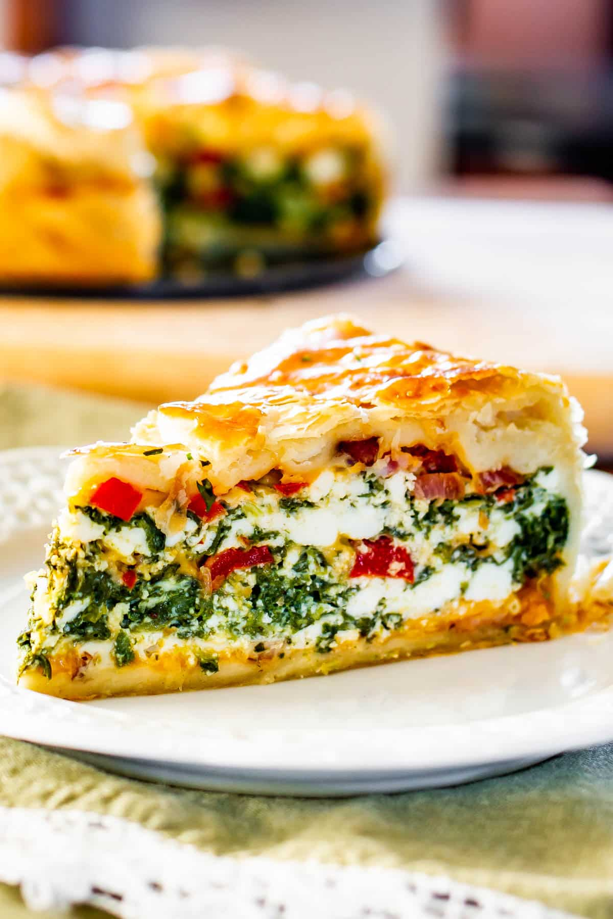 Spinach Ricotta Brunch Bake slice on a white plate
