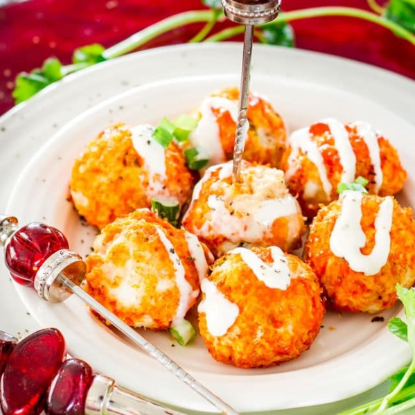 a plate of buffalo chicken meatballs with blue cheese dressing