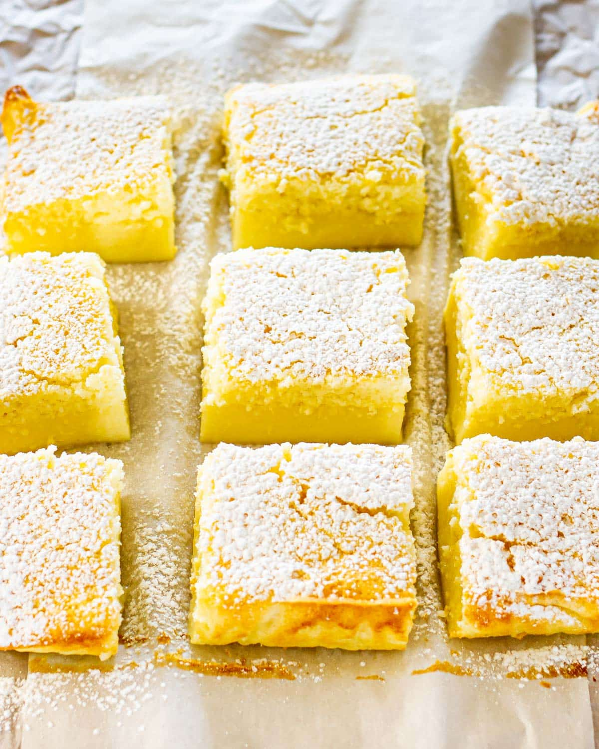 lemon magic cake cut into squares