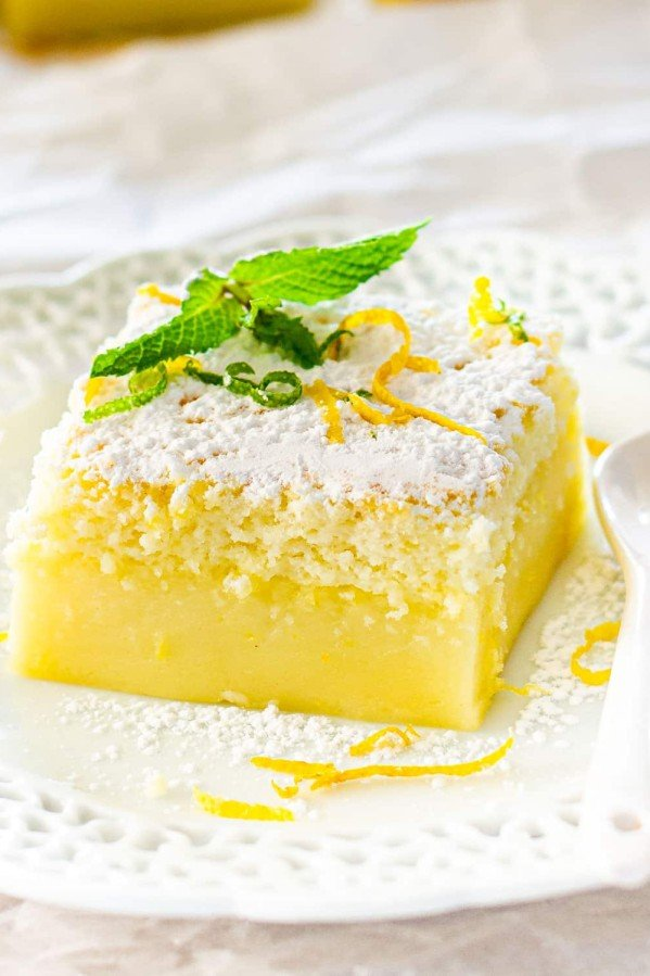 side view shot of a slice of lemon magic cake on a plate